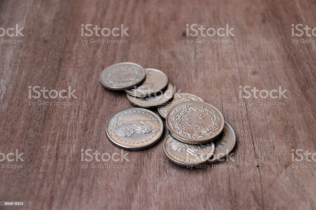 Coins Of Switzerland On The Wooden Floor Swiss Franc Money The