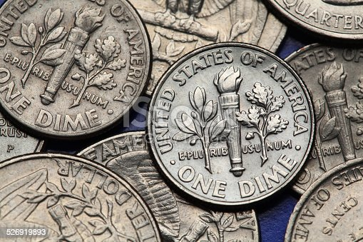 Coins of USA. Torch, oak branch and olive branch depicted on the US dime coin.