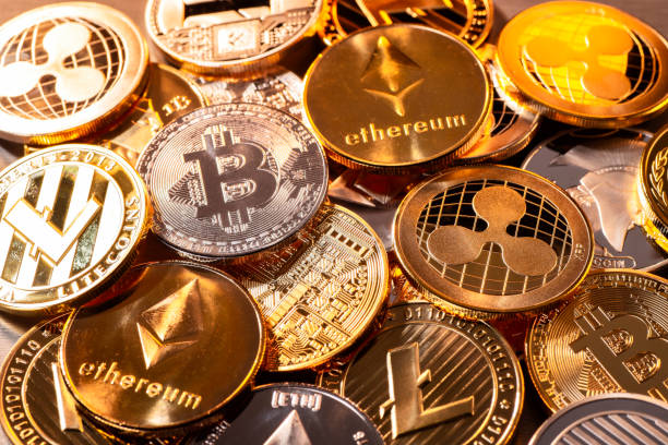 Coins of various cryptocurrencies stock photo