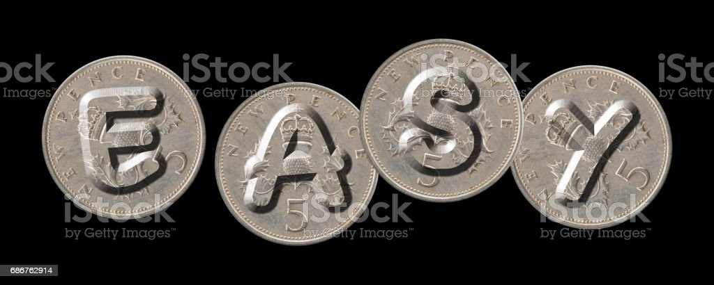 EASY – Coins on black background stock photo