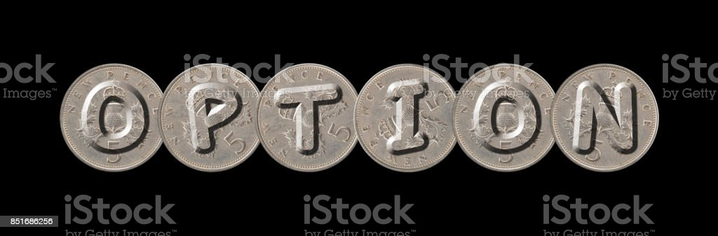 OPTION – Coins on black background stock photo