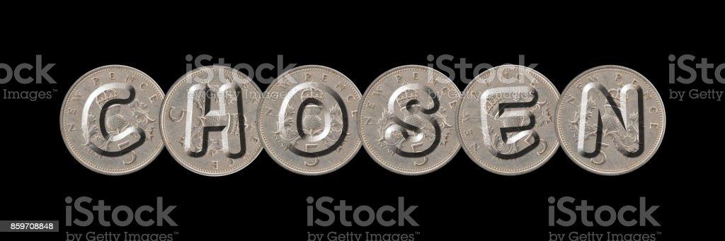 CHOSEN – Coins on black background stock photo
