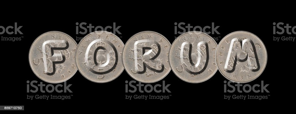 FORUM – Coins on black background stock photo