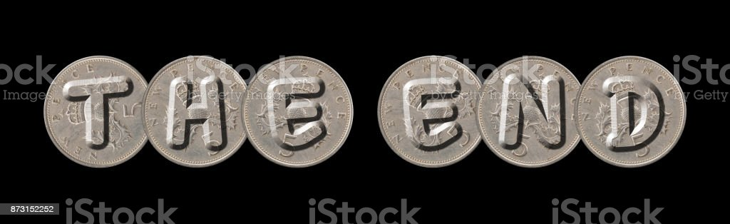 THE END – Coins on black background stock photo