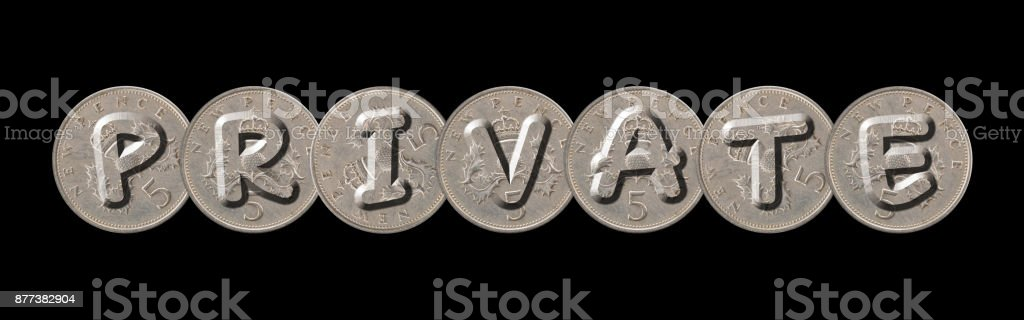 PRIVATE – Coins on black background stock photo