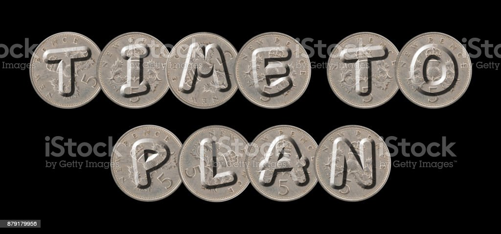 TIME TO PLAN – Coins on black background stock photo