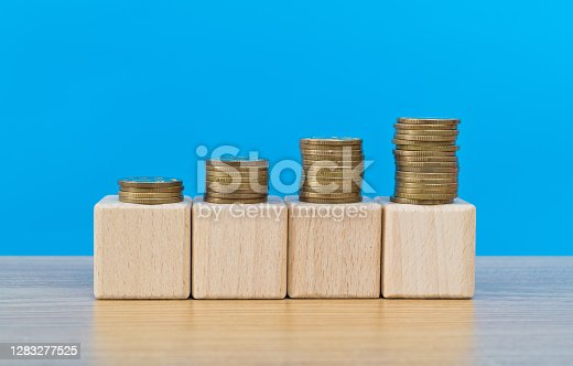 Coins on blank toy blocks.
