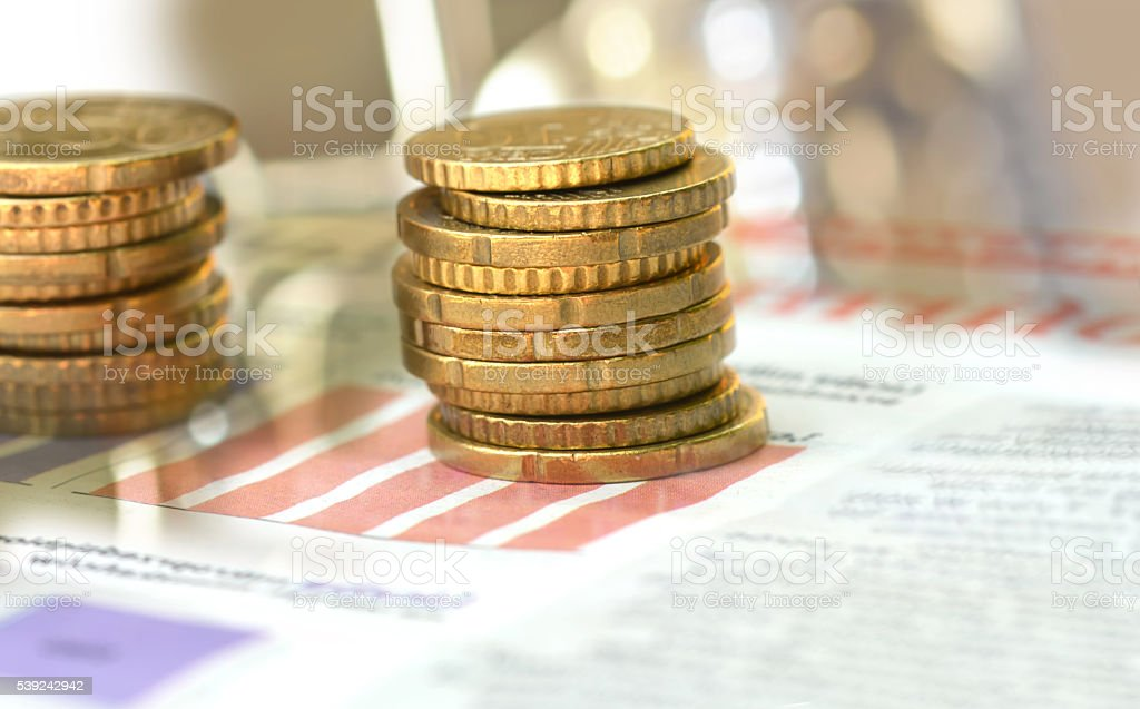 Coins on business page of a newspaper royalty-free stock photo