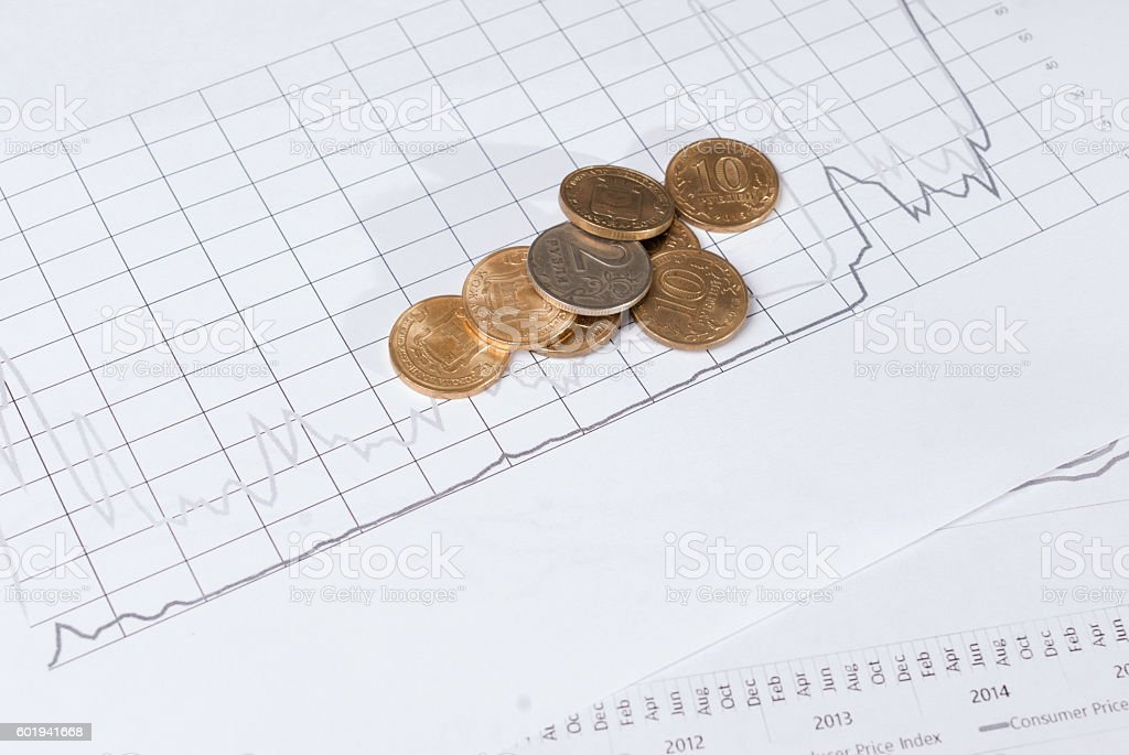 Coins on financial charts. Business and financial concept - foto de stock