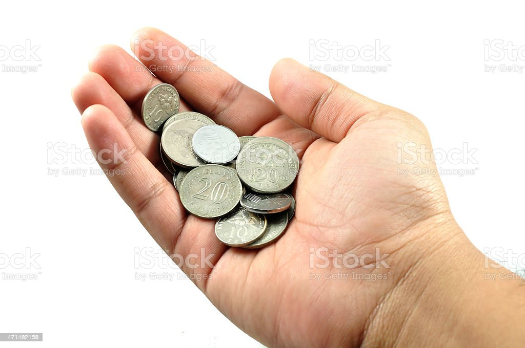 Coins On Hand With White Background stock photo