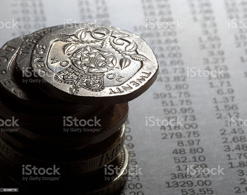 coins on newspaper stock prices royalty-free stock photo