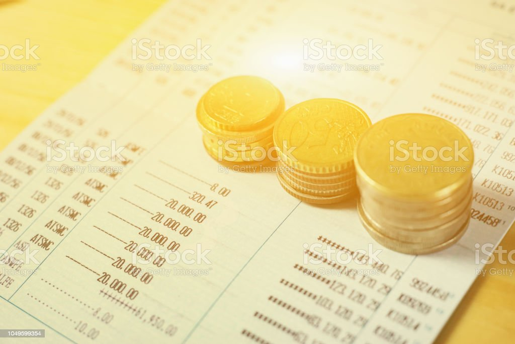 coins on paper work in the office,discussing stock marketing document,book bank,Finances statement, business charts, stock photo