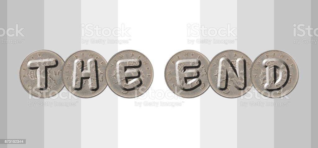 THE END – Coins on striped background stock photo