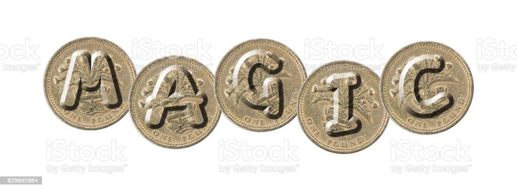 MAGIC – Coins on white background stock photo