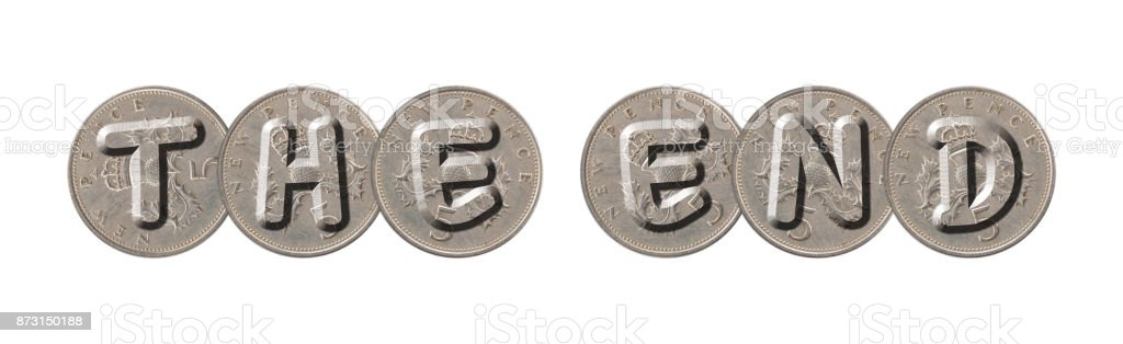 THE END – Coins on white background stock photo