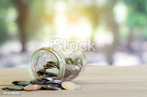 istock Coins on wooden with softlight. Saving money and account growth business concept. Coin thai baht. 1013766354