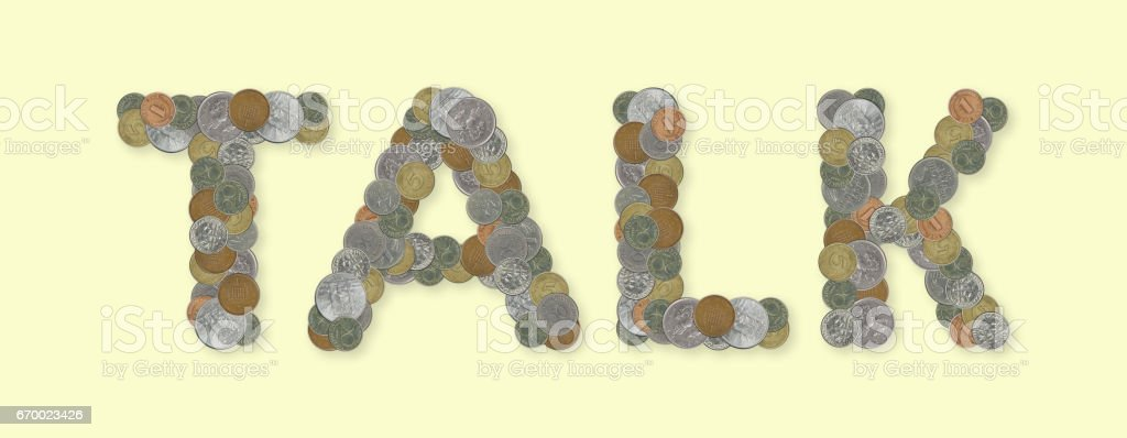 TALK – Coins on yellow background stock photo