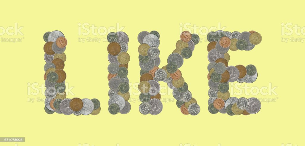 LIKE – Coins on yellow background foto de stock royalty-free