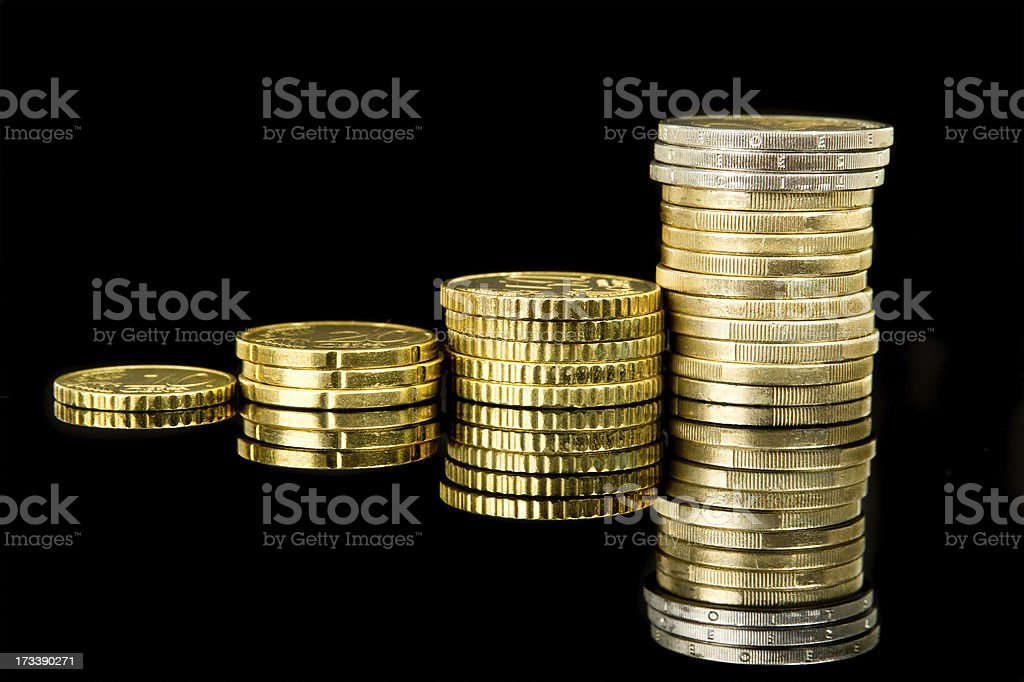 Coins over black royalty-free stock photo