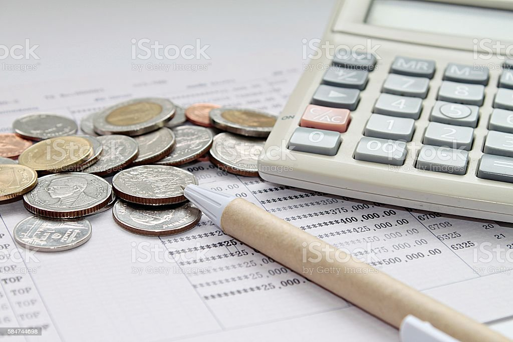 Coins, Pen And Calculator On Savings Account Passbook Royalty Free Stock  Photo