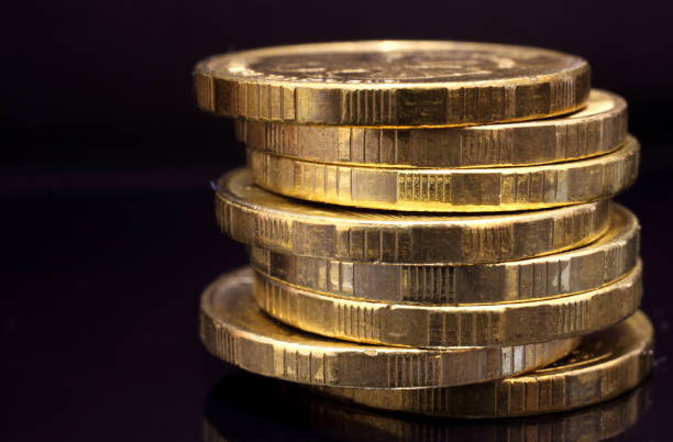 coins - money black background stock photos and pictures
