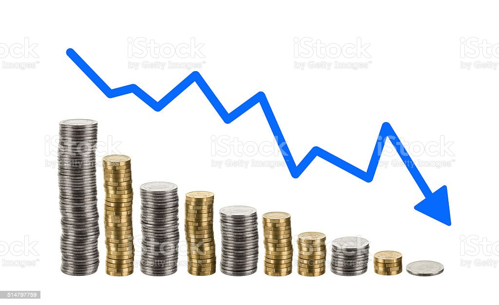 Coins piled high in descending order with trend charts. stock photo