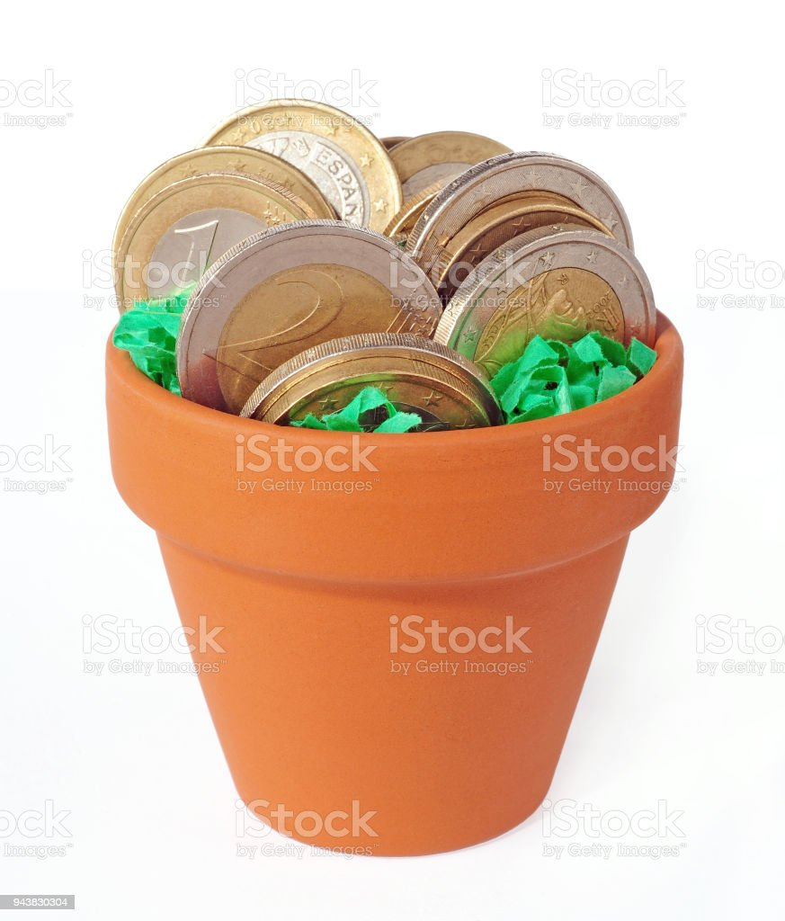 coins potted in clay pot isolated stock photo