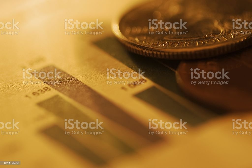 Coins resting on the finance sheet stock photo