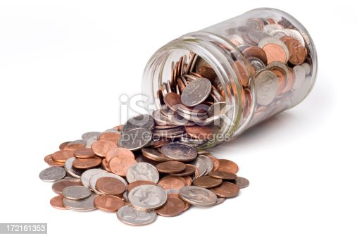 Coins spilling from a jar bank.  Isolated on white with clipping path.