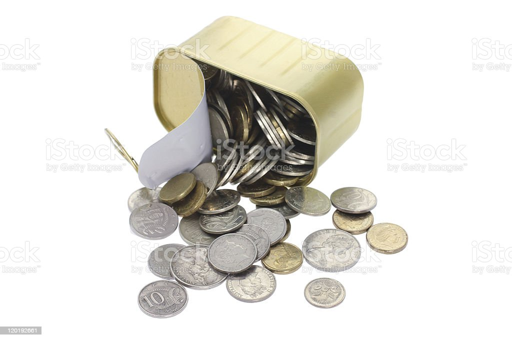 Coins Spilling Out of Tin Can stock photo