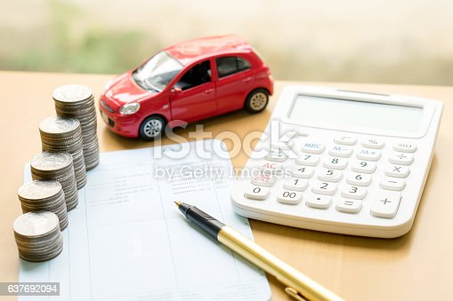istock Coins stack in columns on saving book and car 637692094