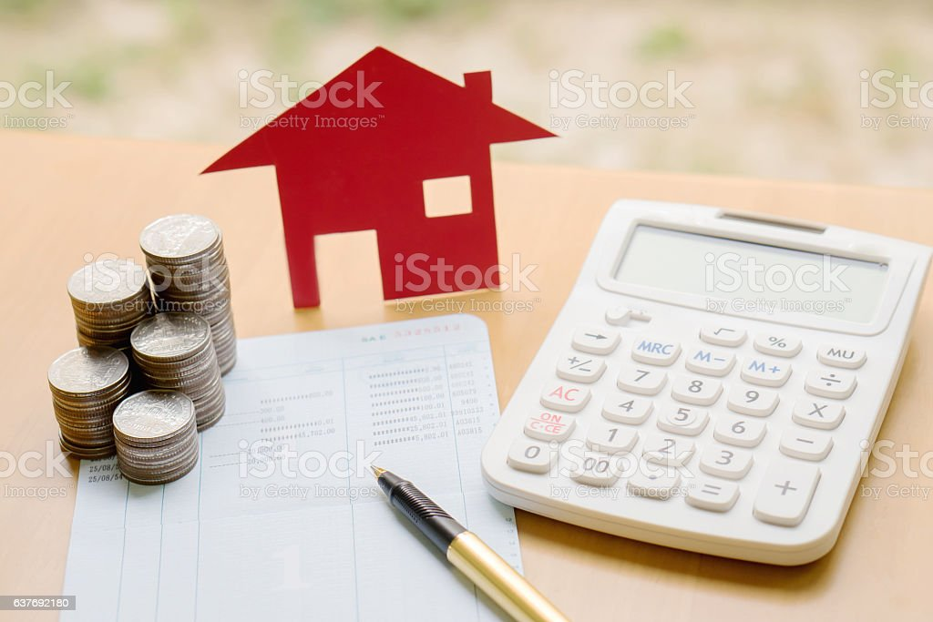 Coins stack in columns with saving book and paper home. – Foto
