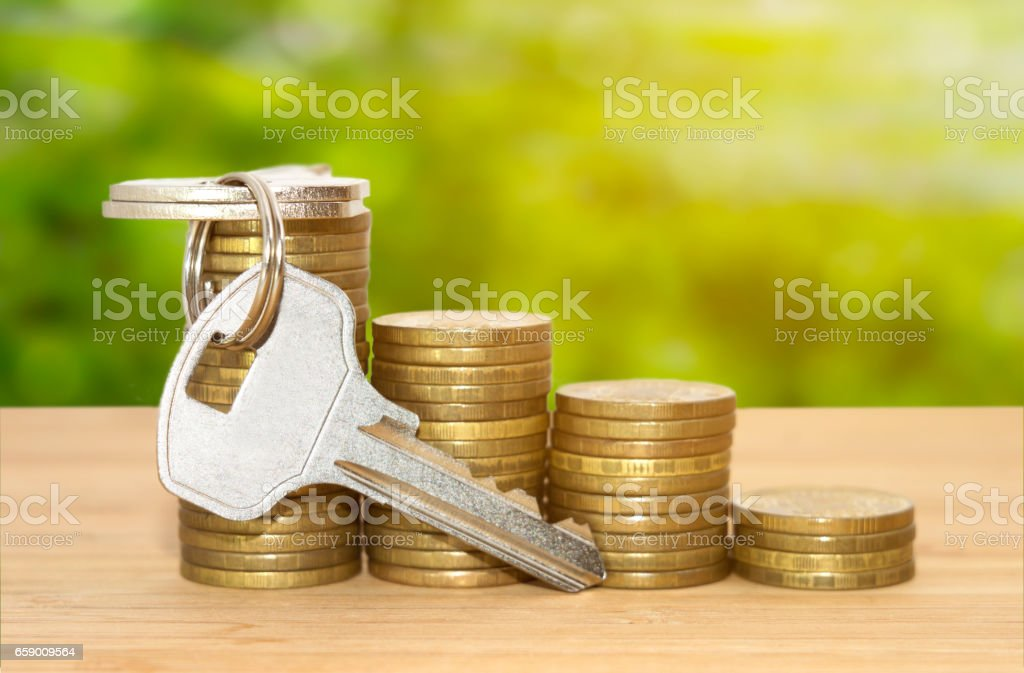 Coins stack with keys royalty-free stock photo