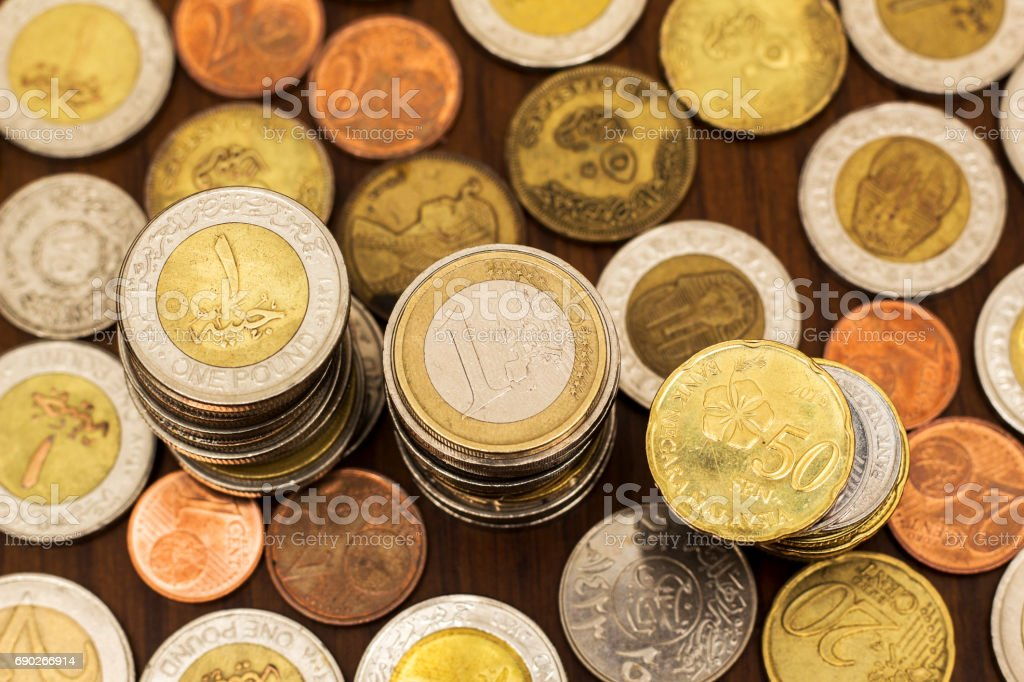 Coins Stacks, Various Currencies, Saving Concept stock photo