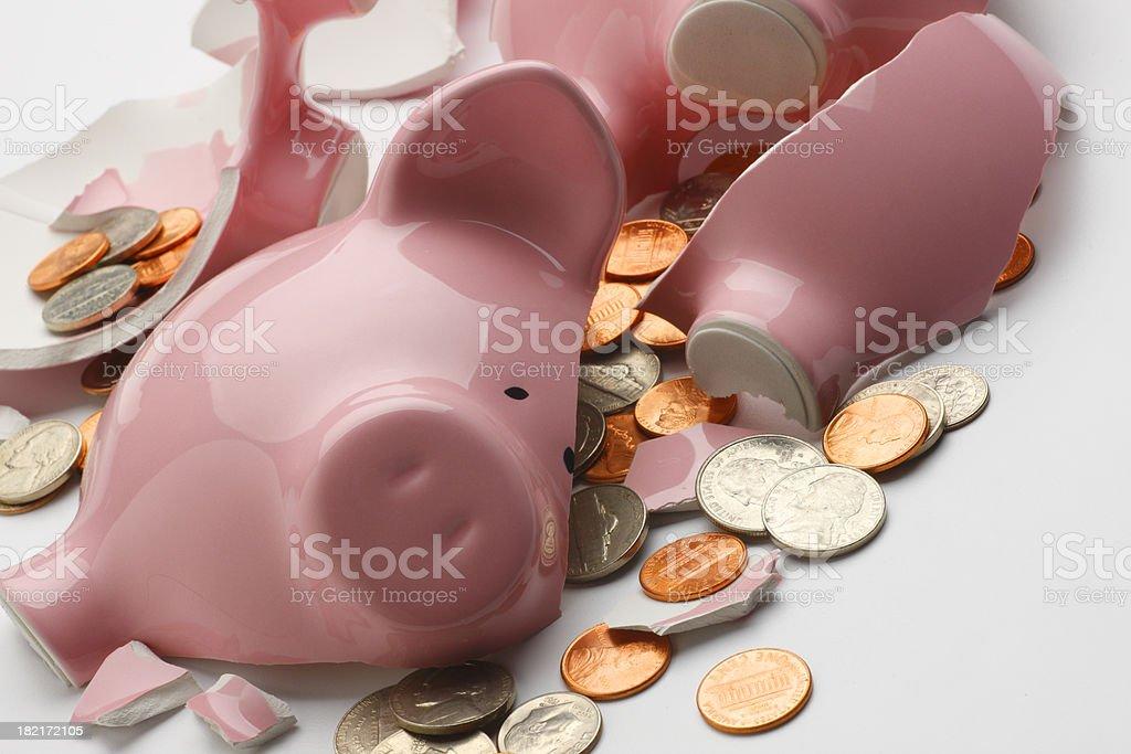 Coins strewn around broken pink piggy bank stock photo