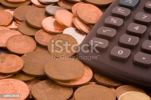 istock Coins with calculator 139903619