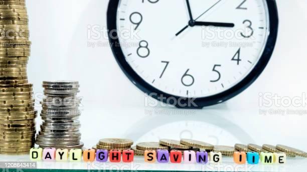 Coins with clock on white table summer daylight saving time turn time picture id1208643414?b=1&k=6&m=1208643414&s=612x612&h=vv8enq3vwreo9d0d5osmx5ky aji0lgu4kanzsq7h70=