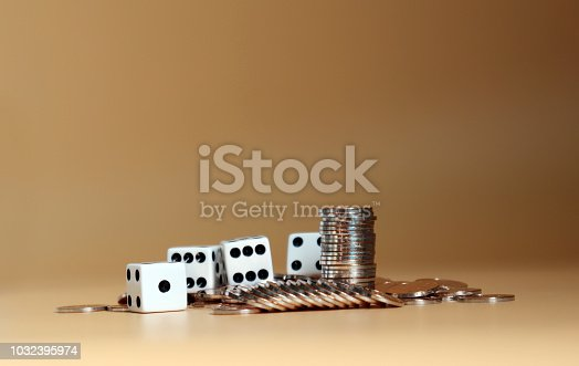 istock Coins with white dice. 1032395974