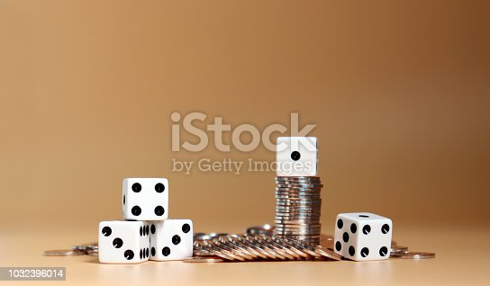 istock Coins with white dice. 1032396014