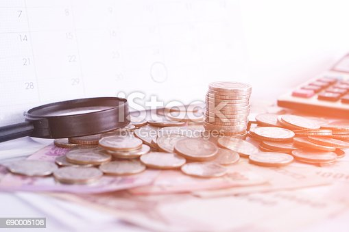 istock coins,money,calculator on wooden desk business investment background 690005108
