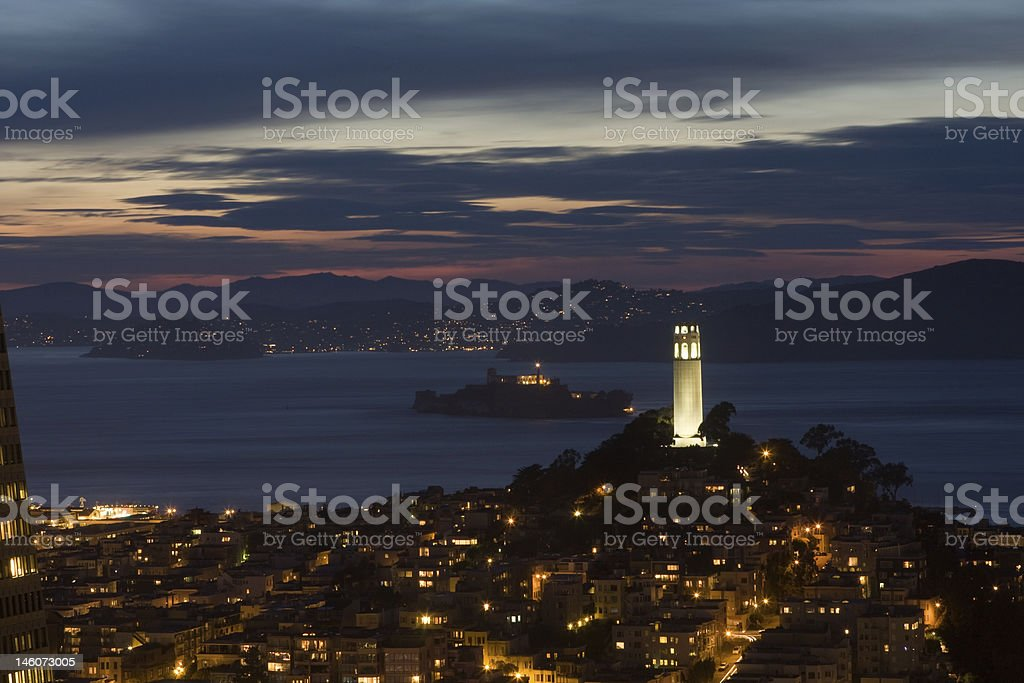 Coit Tower and San Francisco at Night stock photo