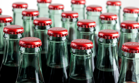 Philadelphia, USA- April 22, 2011: macro studio shot of numerous glass bottle of Coca-Cola. focal point is the front row of bottles with a shallow depth of field