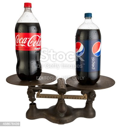 Carol Stream, IL, USA - November 14, 2011: An Antique Jacobs brand scale with plastic 2-liter bottles of Coca-Cola and Pepsi Cola on either side.