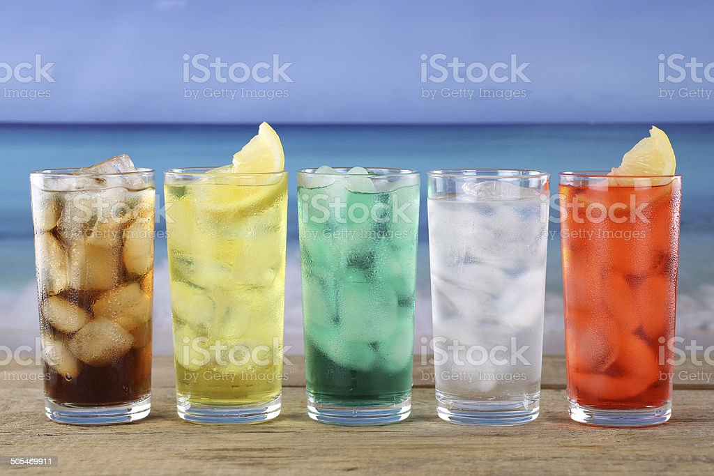 Cola and lemonade soda drinks on the beach stock photo