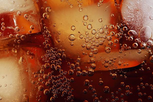 cola close-up - soda pop stock photos and pictures