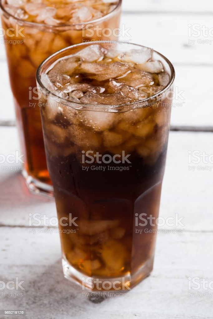 Cola drink glass on white table royalty-free stock photo