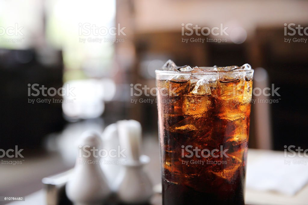 Cola drinking on wood background stock photo