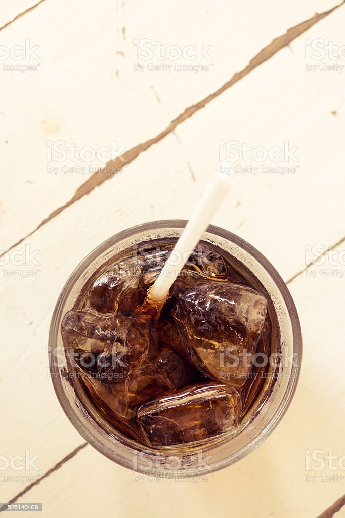 Cola soda soft drink top view on white table stock photo