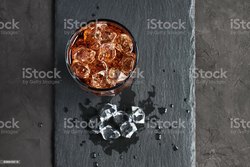 Cola with ice cube stock photo