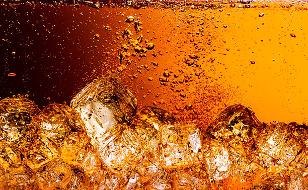 cola with ice. food background - soda pop stock photos and pictures